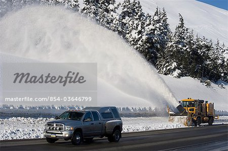 A snowblower follows a truck up the highway in Turnagain Pass, Kenai Peninsula, Southcentral Alaska, Winter Stock Photo - Rights-Managed, Image code: 854-03646799