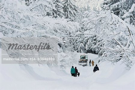 Stranded Girdwood residents look for help from a snowplow driver after a deep snowstorm, Southcentral Alaska, Winter Stock Photo - Rights-Managed, Image code: 854-03646800