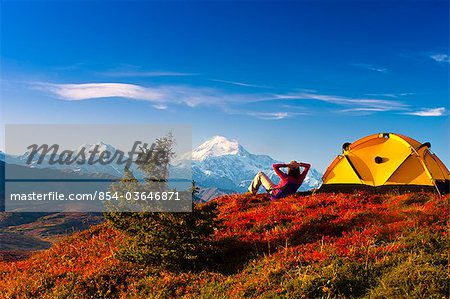 A couple view Mt.McKinley from their campsite in Peters Hills, Denali State Park, Southcentral Alaska, Fall/n Stock Photo - Rights-Managed, Image code: 854-03646871