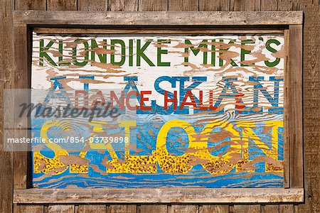 Close up of a sign for Klondike Mike's Alaskan Saloon, Palmer, Southcentral Alaska, Summer. Digitally altered Stock Photo - Rights-Managed, Image code: 854-03739898