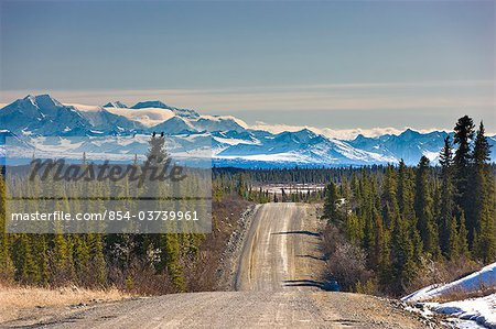 View of the Denali Highway looking east with the Alaska Range in the backgroundl, near Cantwell, Southcentral Alaska, Spring Stock Photo - Rights-Managed, Image code: 854-03739961