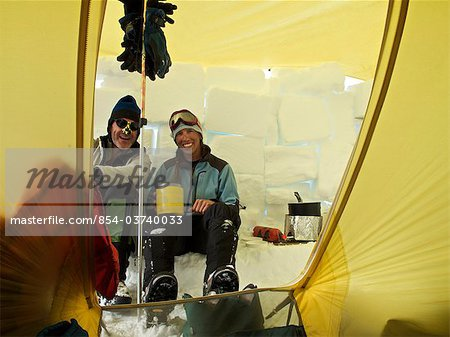 Two climbers in their tent at Camp Three on the West Buttress Route, Kahiltna Glacier on Mt. McKinley, Denali National Park and Preserve, Interior Alaska, Summer Stock Photo - Rights-Managed, Image code: 854-03740033