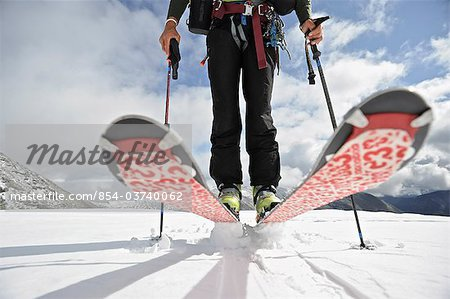 Close up of a backcountry skier on the glacier on the north side of Mt. Chamberlin, Brooks Range, ANWR, Arctic Alaska, Summer Stock Photo - Rights-Managed, Image code: 854-03740062
