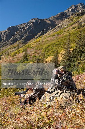 Two male moose hunters scope and glass for game in the Bird Creek drainage area, Chugach Mountains, Chugach National Forest, Southcentral Alaska, Autumn Stock Photo - Rights-Managed, Image code: 854-03845074