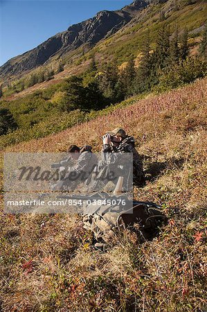Two male moose hunters scope and glass for game in the Bird Creek drainage area, Chugach Mountains, Chugach National Forest, Southcentral Alaska, Autumn Stock Photo - Rights-Managed, Image code: 854-03845076