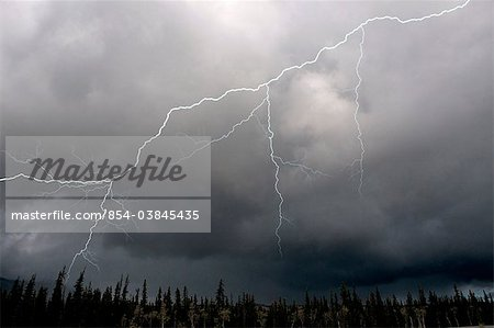 Lightning strike and storm over the Alcan Highway, Yukon Territory, Canada, Summer Stock Photo - Rights-Managed, Image code: 854-03845435