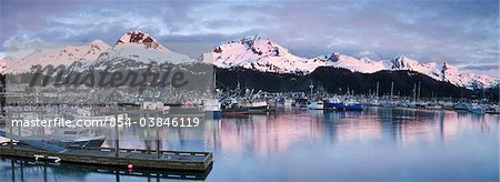 Evening alpenglow on the Chugach Mountains and Mt. Eyak behind the boat harbor at Cordova, Southcentral Alaska, Spring Stock Photo - Rights-Managed, Image code: 854-03846119