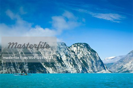 Sea kayakers paddling along cliffs through Muir Inlet, Glacier Bay National Park & Preserve, Southeast Alaska, Summer Stock Photo - Rights-Managed, Image code: 854-05974533