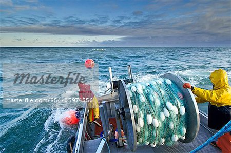 The crew casts out the first set of a gillnet in Ugashik Bay, Bristol Bay region, Southwest Alaska, Summer Stock Photo - Rights-Managed, Image code: 854-05974556