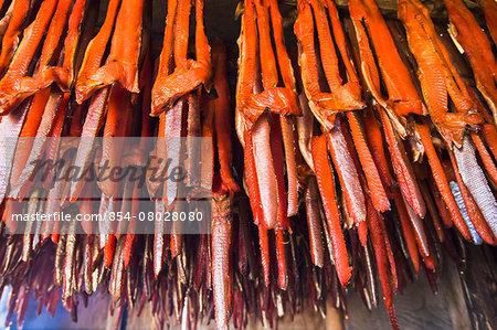 Strips Of Sockeye Salmon Hanging In A Large Smoker For Drying And Smoking; Igiugig Bristol Bay Alaska United States Of America Stock Photo - Rights-Managed, Image code: 854-08028080