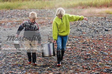 Brother And Sister Fetching Water Near Serpentine Hot Springs, Bering Land Bridge National Preserve (National Park), Northwest Alaska, Autumn Stock Photo - Rights-Managed, Image code: 854-08028183
