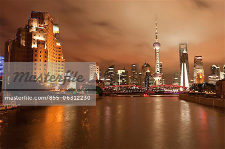 Skyline of Lujiazui Pudong viewed from Suzhou river at night, Shanghai, China Stock Photo - Rights-Managed, Image code: 855-06312230