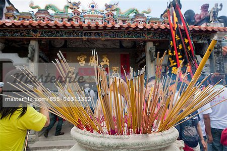 Worshipper offering incense at Pak Tai Temple during the Bun festival, Cheung Chau, Hong Kong Stock Photo - Rights-Managed, Image code: 855-06313352