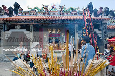 Worshipper offering incense at Pak Tai Temple during the Bun festival, Cheung Chau, Hong Kong Stock Photo - Rights-Managed, Image code: 855-06313354