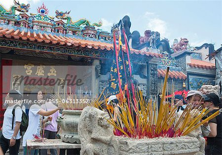 Worshippers offering incense at Pak Tai Temple during the Bun festival, Cheung Chau, Hong Kong Stock Photo - Rights-Managed, Image code: 855-06313357