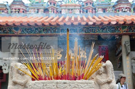 Offering of incense at Pak Tai Temple during the Bun festival, Cheung Chau, Hong Kong Stock Photo - Rights-Managed, Image code: 855-06313359