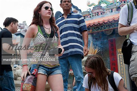 Foreign visitors sharing the atmosphere of the Bun festival at Pak Tai Temple, Cheung Chau, Hong Kong Stock Photo - Rights-Managed, Image code: 855-06313360
