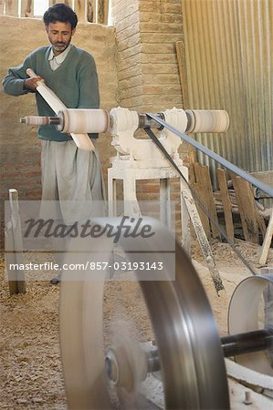 Carpenter making bat in a bat factory, Jammu And Kashmir, India Stock Photo - Rights-Managed, Image code: 857-03193143