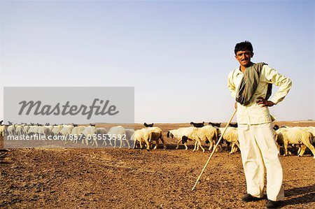 Portrait of a shepherd standing with arms akimbo, Jaisalmer, Rajasthan, India Stock Photo - Rights-Managed, Image code: 857-03553592