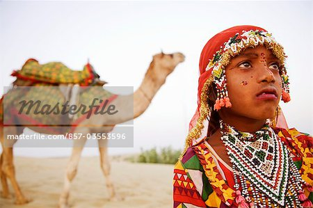 Close-up of a girl with a camel in the background, Jaisalmer, Rajasthan, India Stock Photo - Rights-Managed, Image code: 857-03553596