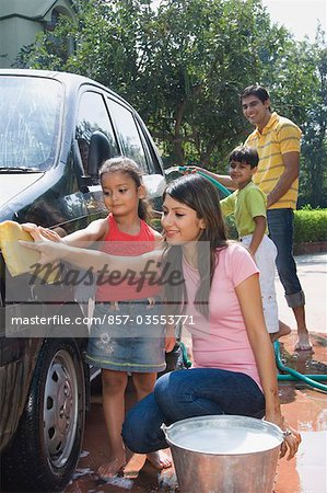 Family washing a car, New Delhi, India Stock Photo - Rights-Managed, Image code: 857-03553771