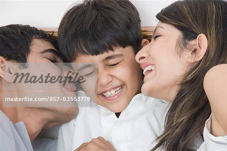 Couple smiling with their son Stock Photo - Rights-Managed, Image code: 857-03553779
