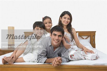 Family smiling on the bed Stock Photo - Rights-Managed, Image code: 857-03553783