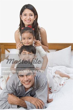 Family having fun on the bed Stock Photo - Rights-Managed, Image code: 857-03553785