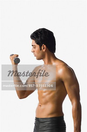 Man exercising with a dumbbell Stock Photo - Rights-Managed, Image code: 857-03553906