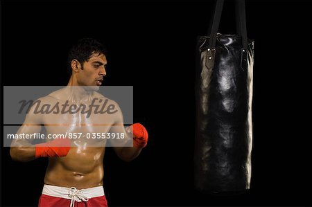 Man practicing boxing Stock Photo - Rights-Managed, Image code: 857-03553918
