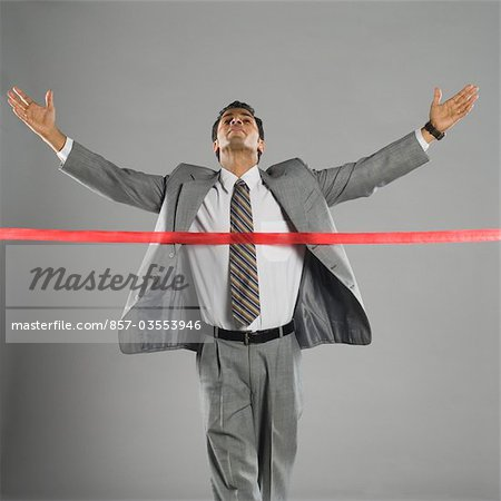 Businessman crossing the finishing line Stock Photo - Rights-Managed, Image code: 857-03553946