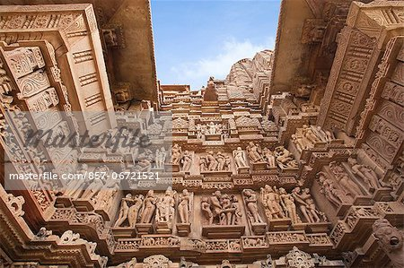 Low angle view of erotic carvings at a temple, Khajuraho, Chhatarpur District, Madhya Pradesh, India Stock Photo - Rights-Managed, Image code: 857-06721521
