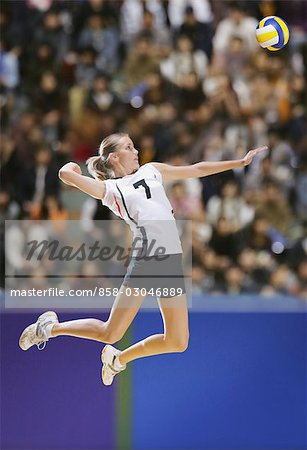 Volleyball Player Striking Mid-Air Stock Photo - Rights-Managed, Image code: 858-03046889
