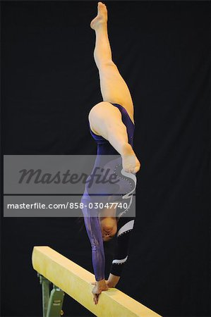 Gymnast performing on balance beam Stock Photo - Rights-Managed, Image code: 858-03047740