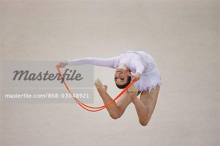 Young woman performing rhythmic gymnastics with rope Stock Photo - Rights-Managed, Image code: 858-03048921