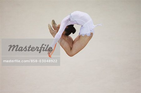 Young woman performing rhythmic gymnastics with rope Stock Photo - Rights-Managed, Image code: 858-03048922