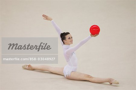 Side view of a young woman doing routine with ball Stock Photo - Rights-Managed, Image code: 858-03048927