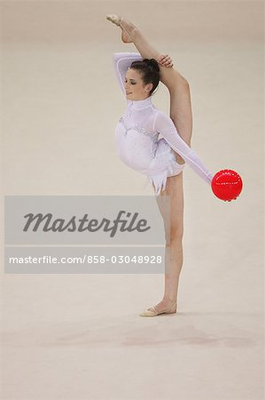 Young woman performing rhythmic gymnastics with ball Stock Photo - Rights-Managed, Image code: 858-03048928