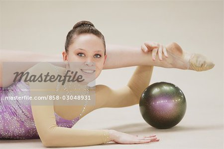 Young woman performing rhythmic gymnastics with ball Stock Photo - Rights-Managed, Image code: 858-03048931