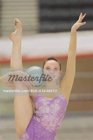 Young woman performing rhythmic gymnastics with ball Stock Photo - Rights-Managed, Image code: 858-03048933