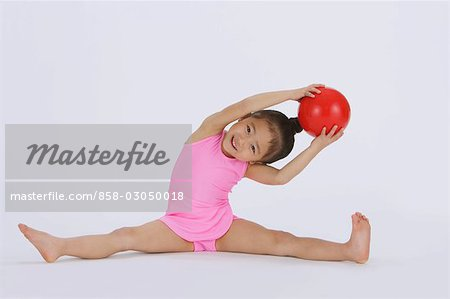 Girl performing rhythmic gymnastic Stock Photo - Rights-Managed, Image code: 858-03050018