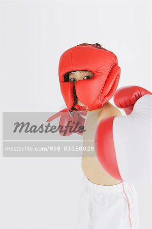 Kick boxer punching and looking at camera Stock Photo - Rights-Managed, Image code: 858-03050028