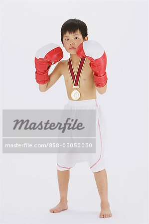 Kick boxer punching and looking at camera Stock Photo - Rights-Managed, Image code: 858-03050030