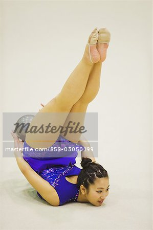 Young woman performing rhythmic gymnastics with ball Stock Photo - Rights-Managed, Image code: 858-03050199