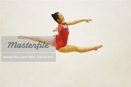 Young woman performing rhythmic gymnastics Stock Photo - Rights-Managed, Image code: 858-03050201