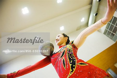 Gymnast performing rhythmic gymnastics with ball Stock Photo - Rights-Managed, Image code: 858-03050207
