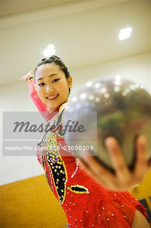 Gymnast performing rhythmic gymnastics with ball Stock Photo - Rights-Managed, Image code: 858-03050209