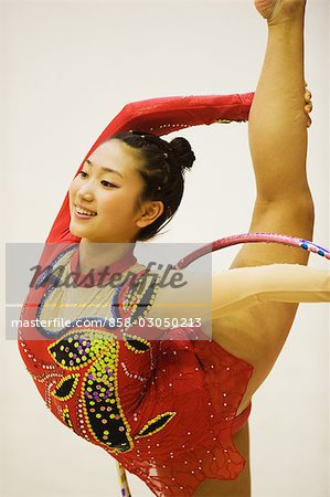 Young woman performing rhythmic gymnastics with hoop Stock Photo - Rights-Managed, Image code: 858-03050213