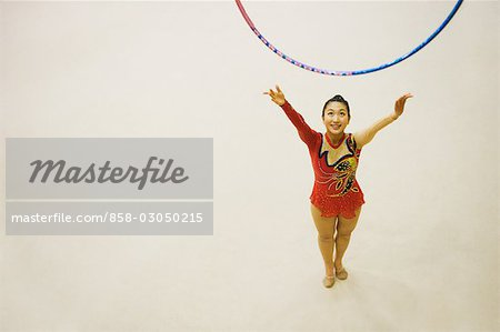 Young woman performing rhythmic gymnastics with hoop Stock Photo - Rights-Managed, Image code: 858-03050215