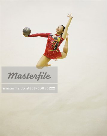 Woman performing rhythmic gymnastics with ball Stock Photo - Rights-Managed, Image code: 858-03050222